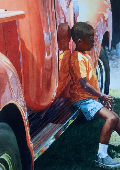 Kid on running board of vintage orange truck