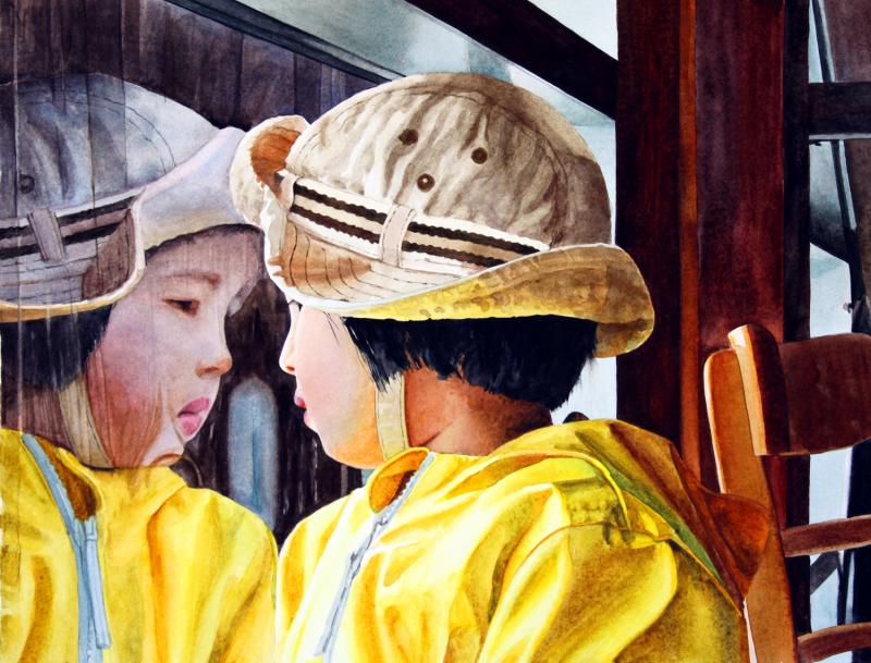 Reflection of child in rainy window